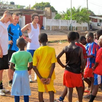 Projects Abroad volunteers hold a team meeting during volunteer rugby coaching in Ghana